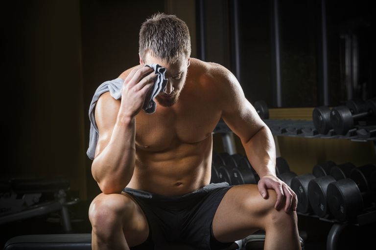 tired caucasian man wiping sweat off forehead in gym 482145031 57f1def63df78c690f613af7