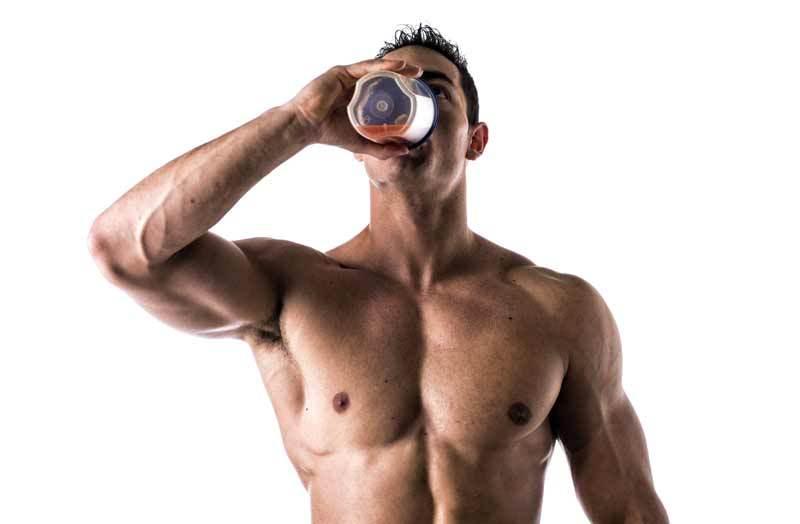 bodtbuilder drinking shaker bottle