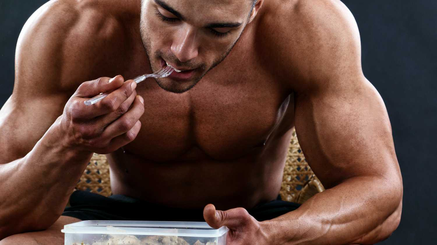 young bodybuilder eating between exercises Lean Muscle ss Feature