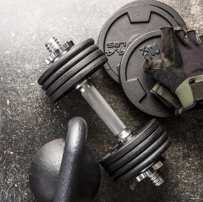 dumbbell and fitness gloves E9WR27H