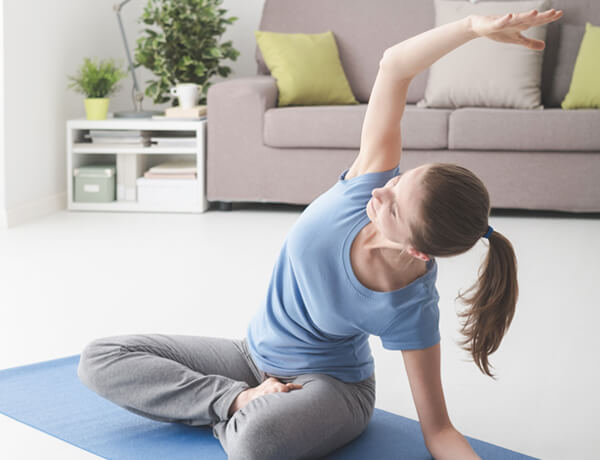 woman practicing yoga at home VXZRF8D