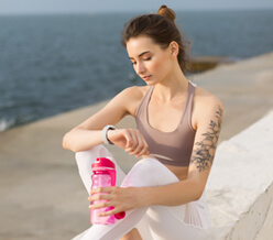 young thoughtful woman in sporty top and white leg XYCRPQT